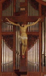 crucifix behind altar