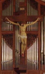 crucifix behind altar
